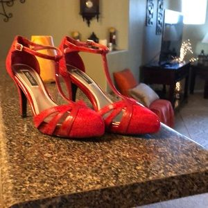 Red T-strapped heels